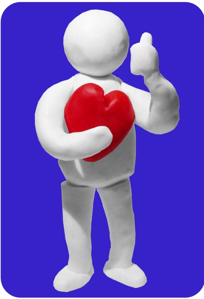 Dit klei-mannetje die een rood hart vast houdt en een duim omhoog houdt, staat symbool voor het uit-balans-programma van de Davis-methode.